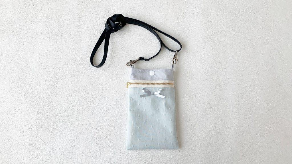 スマホポーチの作り方|市販の持ち手完成写真|ハンドメイド 初心者のための洋裁メディア縫いナビ|丸石織物